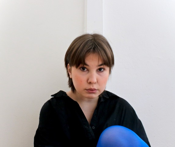 Portrait of a person sitting on a floor